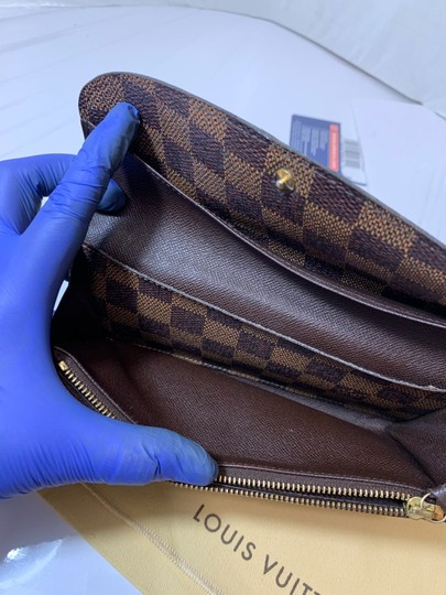 Louis Vuitton Emilie Bifold wallet with duster Image 10