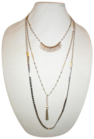 Preload https://img-static.tradesy.com/item/25123862/silver-and-gold-riad-layering-necklace-0-1-540-540.jpg