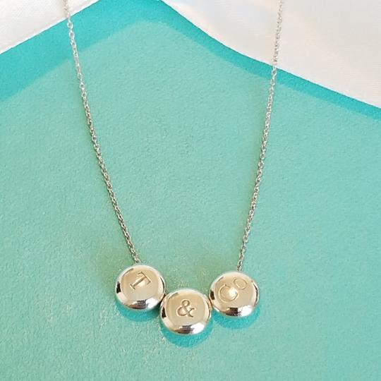 Preload https://img-static.tradesy.com/item/25128670/tiffany-and-co-rare-triple-dots-t-and-co-necklace-0-3-540-540.jpg