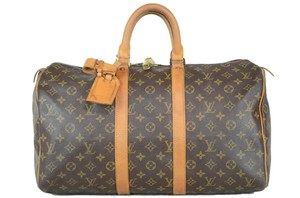 Louis Vuitton Keepall Monogram Tote in Brown