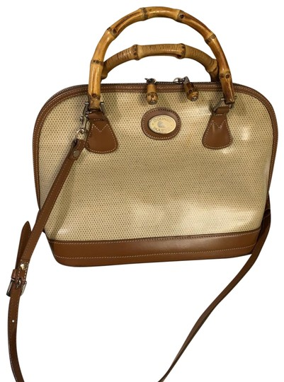 Preload https://img-static.tradesy.com/item/25139114/dooney-and-bourke-vintage-cream-and-brown-patent-leather-satchel-0-1-540-540.jpg