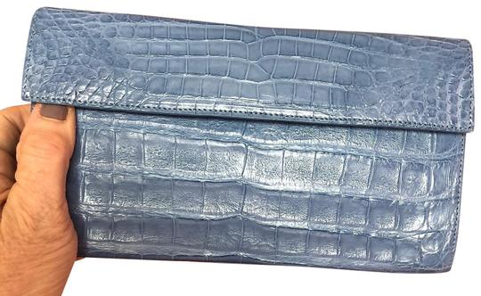 Preload https://img-static.tradesy.com/item/25139150/nancy-gonzalez-matte-light-blue-crocodile-skin-leather-clutch-0-1-540-540.jpg