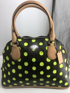 Coach Satchel in Signature print brown and black with green neon yellow dots