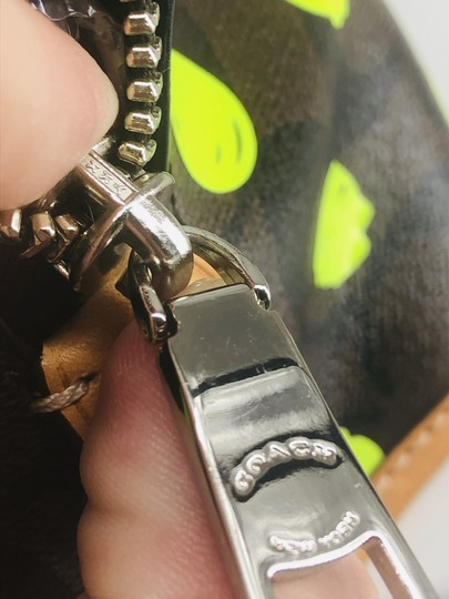 Coach Satchel in Signature print brown and black with green neon yellow dots Image 6