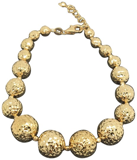 Preload https://img-static.tradesy.com/item/25149560/18k-yellow-gold-diamond-cut-balls-bracelet-0-1-540-540.jpg
