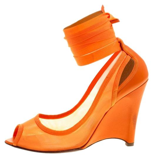 Preload https://img-static.tradesy.com/item/25151454/fendi-orange-mesh-and-leather-ankle-wrap-cut-out-wedge-pumps-size-eu-37-approx-us-7-regular-m-b-0-1-540-540.jpg