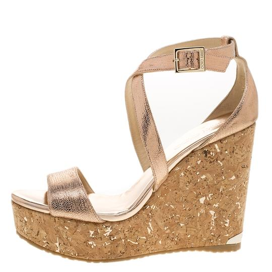 Preload https://img-static.tradesy.com/item/25152379/jimmy-choo-metallic-bronze-suede-portia-cork-wedge-cross-strap-sandals-size-eu-39-approx-us-9-regula-0-0-540-540.jpg
