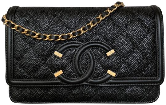 Preload https://img-static.tradesy.com/item/25154816/chanel-wallet-on-classic-filigree-caviar-with-gold-tone-chain-black-leather-cross-body-bag-0-1-540-540.jpg