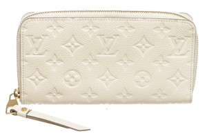 Prada Cream Empreinte Zippy Wallet 489797
