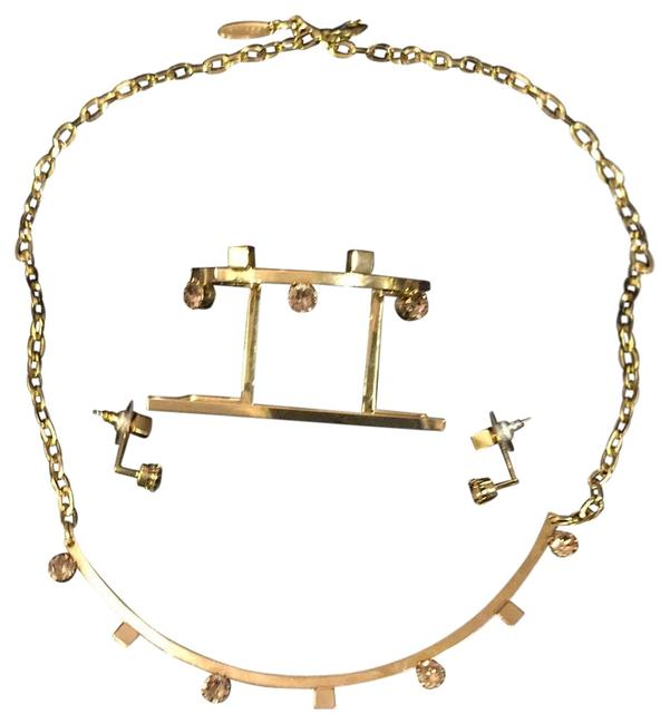 Item - Polished Gold Tone with Pink Crystal Stones Set Of Three Pieces: Necklace Bangle Bracelet and Earrings