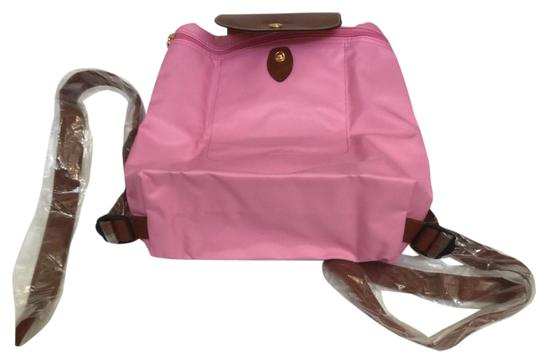 Preload https://img-static.tradesy.com/item/25170273/longchamp-le-pliage-pinkgold-nylon-backpack-0-1-540-540.jpg