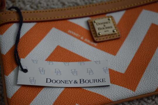 Dooney & Bourke Night Out Leather Wristlet in Orange Image 1