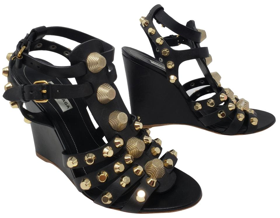 materiali superiori varietà di disegni e colori 100% autentico Balenciaga Black Leather Gold-tone Studded Arena Wedge Sandals ...