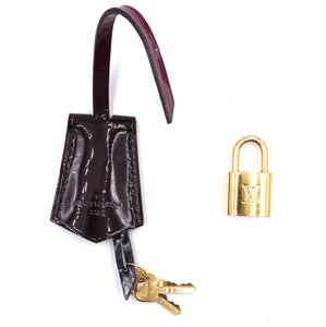 Louis Vuitton Clochette with gold tone Lock and keys set for vernis line bags