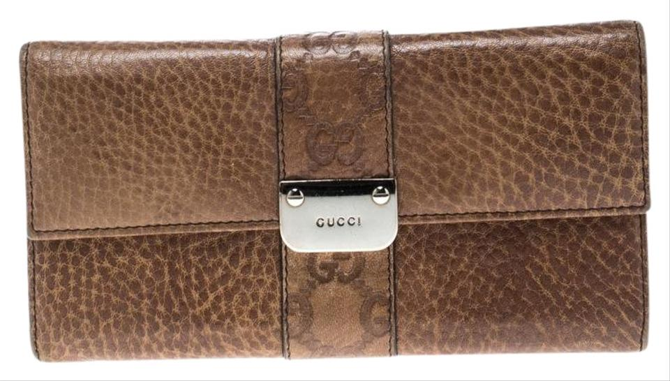 ffe25634400 Gucci Brown Leather Guccissima Trim Flap Continental Wallet Image 0 ...
