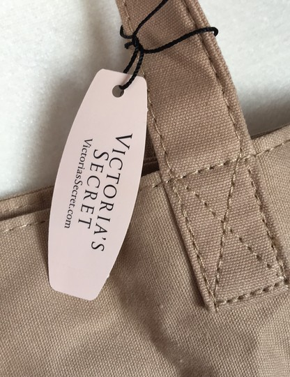 Victoria's Secret Tote in canvas with gromet details. just found in my closet. take her home Image 2