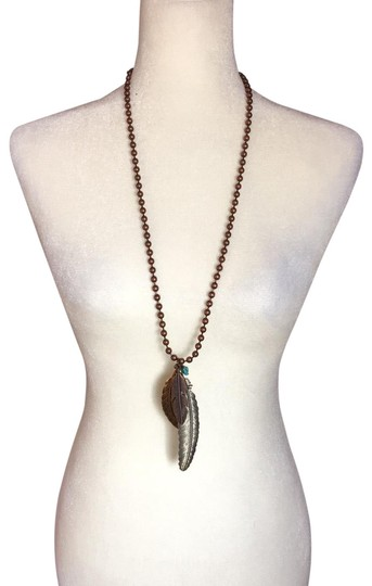 Preload https://img-static.tradesy.com/item/25193727/bronze-feathers-and-turquoise-necklace-0-1-540-540.jpg