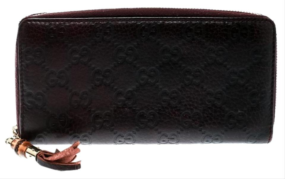b88354be428b Gucci Burgundy Guccissima Leather Bamboo Tassel Zip Around Wallet Image 0  ...