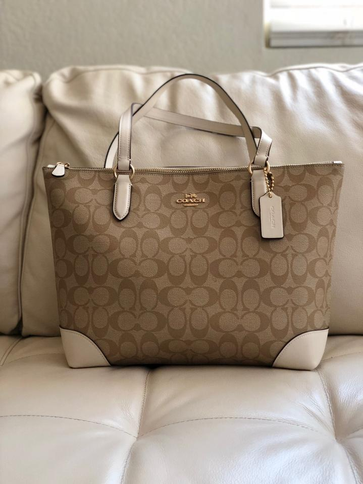 a44b3c2a Coach Zip Top In Signature Wallet Chalk/Light Khaki Coated Canvas Tote 47%  off retail