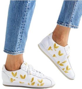 Nike white and gold Athletic