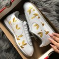 Nike white and gold Athletic Image 1