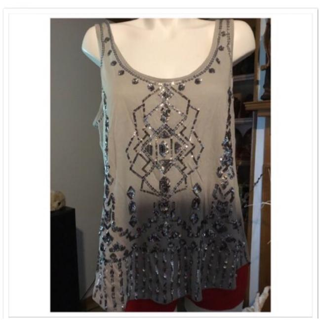 Preload https://img-static.tradesy.com/item/25218522/express-grey-high-low-sequin-blouse-size-14-l-0-0-650-650.jpg