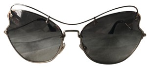 04d14cbf8a7 Miu Miu Sunglasses - Up to 70% off at Tradesy