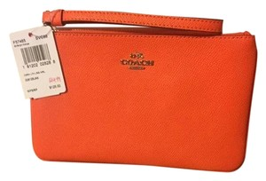 Coach Coach Orange Leather Large Wristlet Clutch f57465