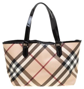 67104fb98a46 Added to Shopping Bag. Burberry Pvc Leather Tote in Beige. Burberry Beige  Black Super Nova Check ...