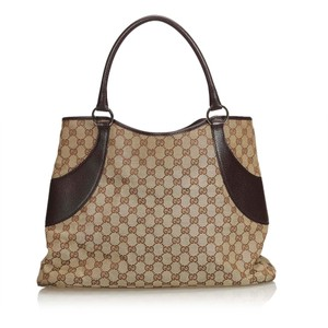aaa2fdd49c9 Gucci Beige Fabric Italy Brown Canvas Leather Tote - Tradesy