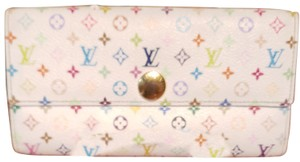 Louis Vuitton Louis Monogram Merkami multi colored wallet with pink interior. Hard to find in such good shape. Minimal signs of use. 10 credit card slots, 3 bill compartments, and one change holder with zip closure. Beautiful wallet...love, love, love