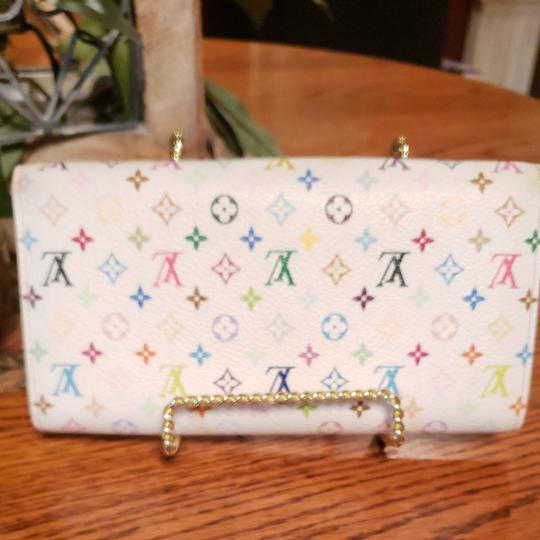 Louis Vuitton Louis Monogram Merkami multi colored wallet with pink interior. Hard to find in such good shape. Minimal signs of use. 10 credit card slots, 3 bill compartments, and one change holder with zip closure. Beautiful wallet...love, love, love Image 1