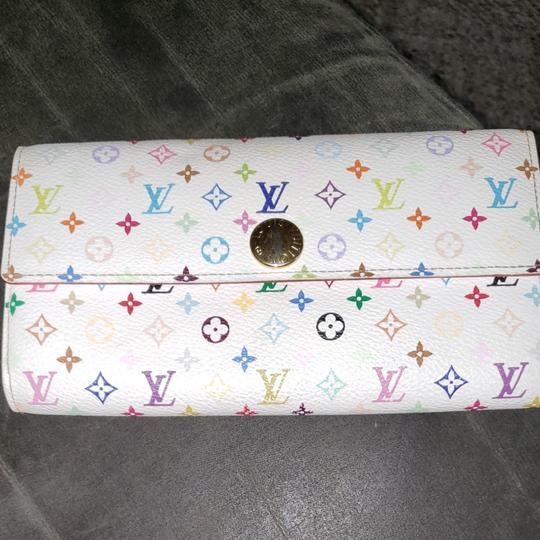 Louis Vuitton Louis Monogram Merkami multi colored wallet with pink interior. Hard to find in such good shape. Minimal signs of use. 10 credit card slots, 3 bill compartments, and one change holder with zip closure. Beautiful wallet...love, love, love Image 10