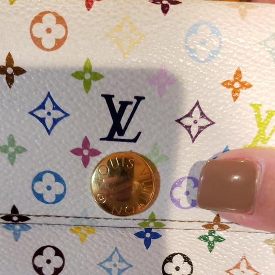 Louis Vuitton Louis Monogram Merkami multi colored wallet with pink interior. Hard to find in such good shape. Minimal signs of use. 10 credit card slots, 3 bill compartments, and one change holder with zip closure. Beautiful wallet...love, love, love Image 4