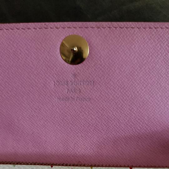 Louis Vuitton Louis Monogram Merkami multi colored wallet with pink interior. Hard to find in such good shape. Minimal signs of use. 10 credit card slots, 3 bill compartments, and one change holder with zip closure. Beautiful wallet...love, love, love Image 5