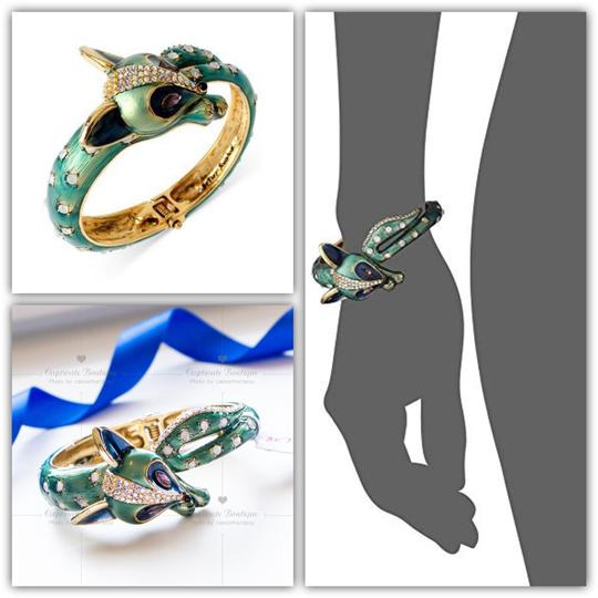 Preload https://img-static.tradesy.com/item/25241004/betsey-johnson-teal-blue-all-wrapped-up-fox-hinged-bangle-bracelet-0-0-540-540.jpg