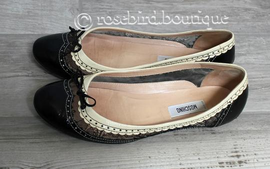 Moschino Patent Leather Wingtip Lace Bow Round Toe Black & Ivory Cream Flats Image 1