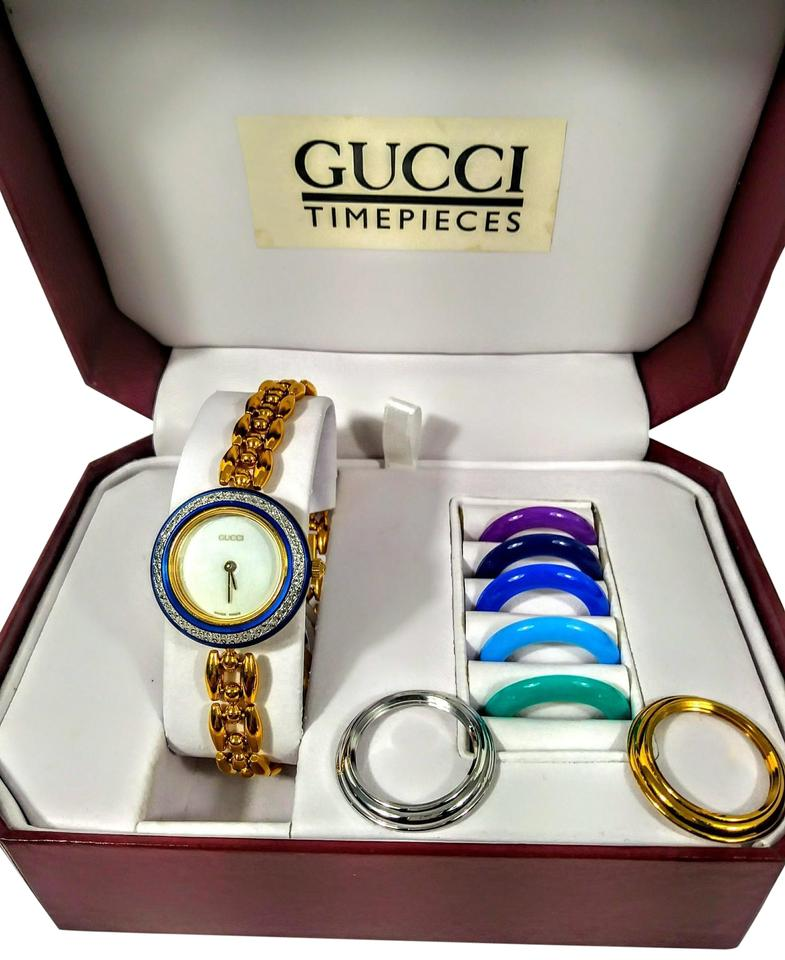 47ee47a4422 Gucci Gold and Blue Vintage Multi Color Interchangeable Bezel Swiss Made  Watch