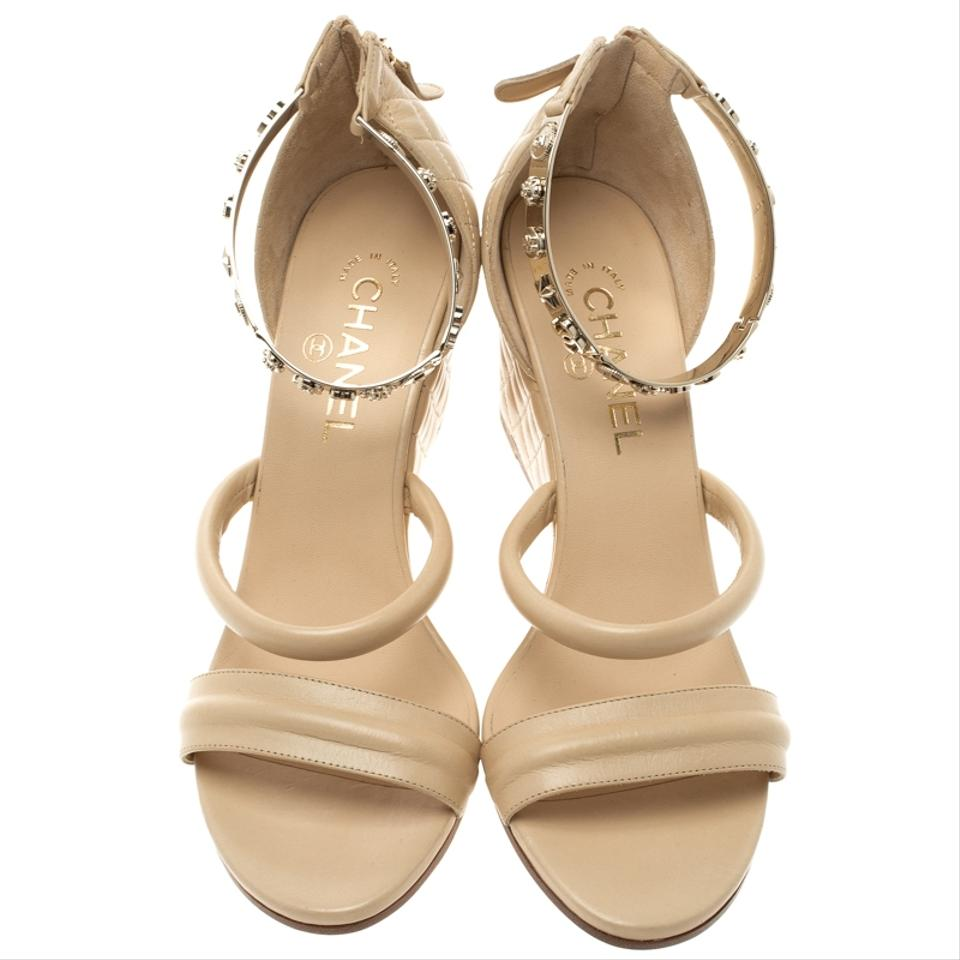 2541df6bd3a4 Chanel Quilted Leather Charm Embellished Ankle Beige Sandals Image 7.  12345678