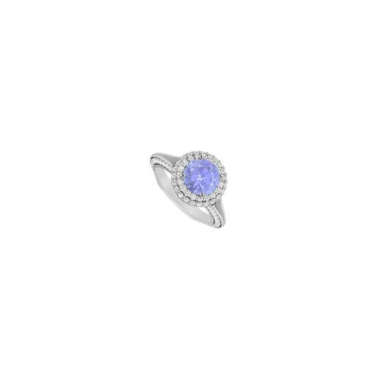 Preload https://img-static.tradesy.com/item/25268575/blue-created-tanzanite-and-cubic-zirconia-halo-engagement-in-14k-white-ring-0-0-540-540.jpg