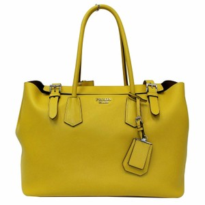 e1b8deeeaaaa Prada : Calfskin Leather Mint Condition Tote in yellow