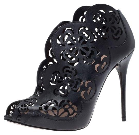 Preload https://img-static.tradesy.com/item/25271431/alexander-mcqueen-black-floral-laser-cut-leather-ankle-bootsbooties-size-eu-36-approx-us-6-regular-m-0-1-540-540.jpg