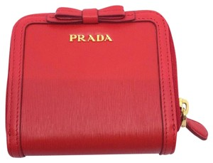 Prada Prada Portafoglio Light Red Vitello Move Zip Flap Bow Wallet 1ML522