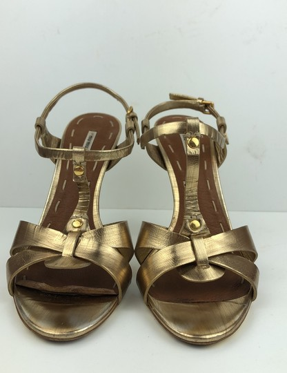 Miu Miu Gold Pumps Image 1