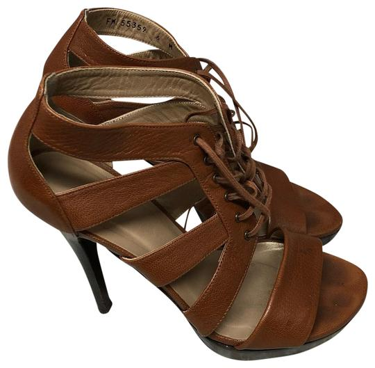 Preload https://img-static.tradesy.com/item/25272693/stuart-weitzman-brown-lace-up-leather-heels-m-pumps-size-us-6-regular-m-b-0-2-540-540.jpg