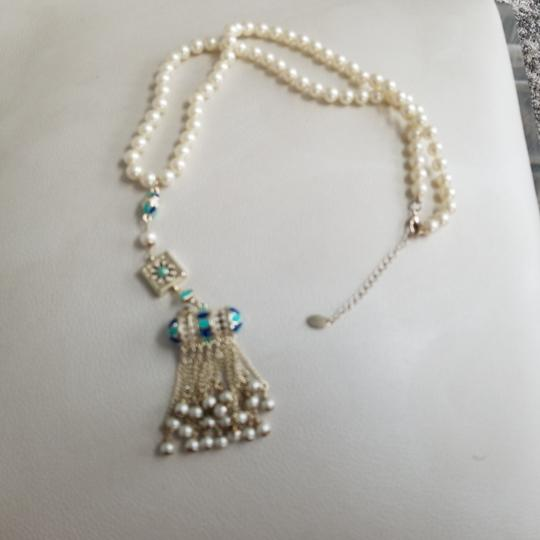 Chanel Chanel white pearl with golden charm 23 inches with charm length 18 inches, there is cc logo in the charm Image 1
