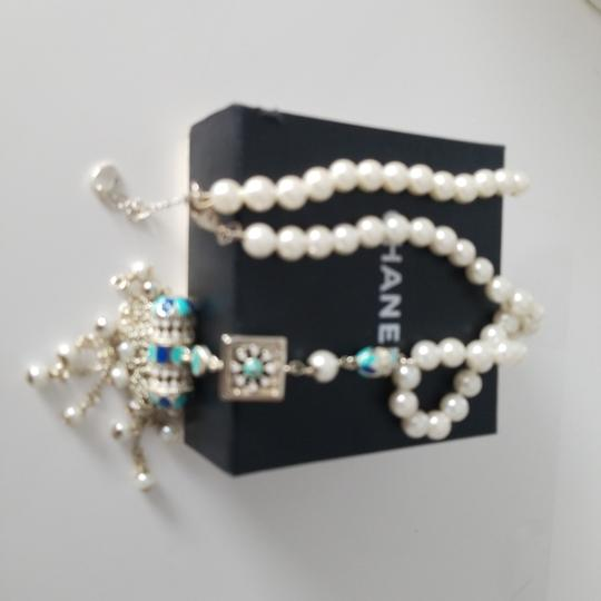 Chanel Chanel white pearl with golden charm 23 inches with charm length 18 inches, there is cc logo in the charm Image 2