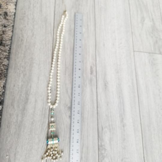 Chanel Chanel white pearl with golden charm 23 inches with charm length 18 inches, there is cc logo in the charm Image 4