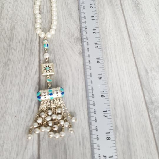 Chanel Chanel white pearl with golden charm 23 inches with charm length 18 inches, there is cc logo in the charm Image 5