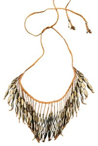 Anthropologie textile and metal fringe necklace.